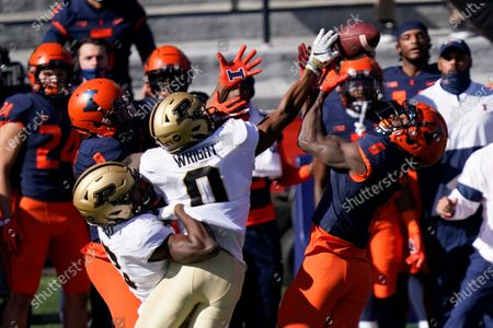 Purdue wide receiver Milton Wright (0) keeps Illinois defensive back Tony Adams (6) from intercepting a pass during the first half of an NCAA college football game, in Champaign, Ill