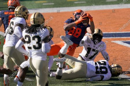 Illinois tight end Daniel Imatorbhebhe (88) falls into the end zone for a touchdown as Purdue cornerback Simeon Smiley (29) and DJ Johnson (17) defend during the second half of an NCAA college football game, in Champaign, Ill. Purdue won 31-24