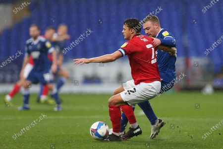 Perry Ng of Crewe Alexandra holds off a challenge from Freddie Sears of Ipswich Town