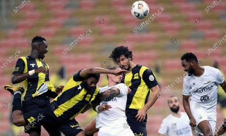 Al-Ittihad's players Ziyad Al-Sahafi (L) and Hamdan Al-Shamrani (2-L) and Ahmed Hegazi (2-R) vie for the ball against Al-Ahli's Mohammed Al-Khabrani (R) and Ljubomir Fejsa (C) during the Saudi Professional League soccer match between Al-Ittihad and Al-Ahli at King Abdullah Sport City Stadium, 30 kilometers north of Jeddah, Saudi Arabia, 31 October 2020.