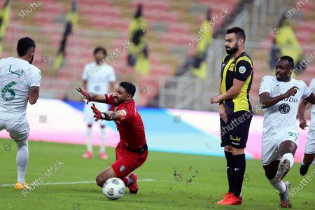 Stock Image of Al-Ahli's goalkeeper Yasser Al-Mosailem (2-L) tries to save the ball during the Saudi Professional League soccer match between Al-Ittihad and Al-Ahli at King Abdullah Sport City Stadium, 30 kilometers north of Jeddah, Saudi Arabia, 31 October 2020.
