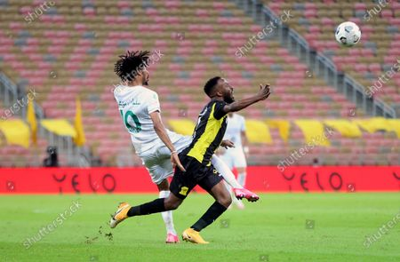 Al-Ittihad's player Fahad Al Muwallad (R) in action against Al-Ahli's Salman Al-Muwashar (L) during the Saudi Professional League soccer match between Al-Ittihad and Al-Ahli at King Abdullah Sport City Stadium, 30 kilometers north of Jeddah, Saudi Arabia, 31 October 2020.