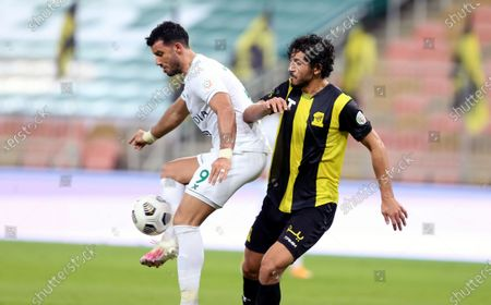 Al-Ittihad's player Ahmed Hegazi (R) in action against Al-Ahli's Omar Al-Soma (L) during the Saudi Professional League soccer match between Al-Ittihad and Al-Ahli at King Abdullah Sport City Stadium, 30 kilometers north of Jeddah, Saudi Arabia, 31 October 2020.