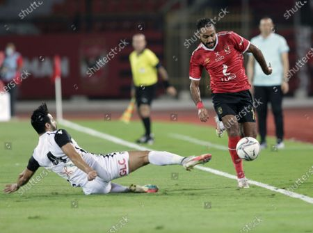 Stock Image of Al-Ahly  player Mahmoud Kahraba (R) in action against Tala'ea El Gaish SC player Ahmed Samy (L) during the Egyptian Premier League soccer match between Al-Ahly and Tala'ea El Gaish SC at Salam Stadium in Cairo Egypt, 31 October  2020