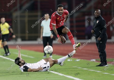 Al-Ahly  player Mahmoud Kahraba (R) in action against Tala'ea El Gaish SC player Ahmed Samy (down) during the Egyptian Premier League soccer match between Al-Ahly and Tala'ea El Gaish SC at Salam Stadium in Cairo Egypt, 31 October  2020