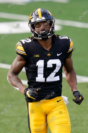 Iowa wide receiver Brandon Smith runs on the field during the first half of an NCAA college football game against Northwestern, in Iowa City, Iowa
