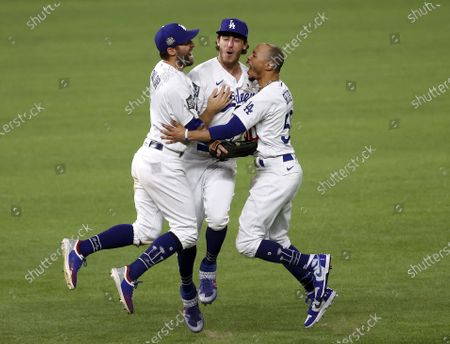 Los Angeles Dodgers players (L-R) Chris Taylor, Cody Bellinger and Mookie Betts celebrate after defeating the Tampa Bay Rays in Major League Baseball's World Series Game six to win the World Series at Globe Life Field in Arlington, Texas, USA, 27 October 2020. The Dodgers win the best-of-seven series 4-2.