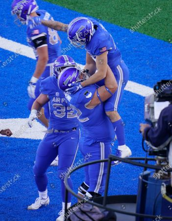 Air Force wide receiver Brandon Lewis, top, celebrates his run for a touchdown with guard Hawk Wimmer in the first half of an NCAA college football game against Boise State, at Air Force Academy, Colo