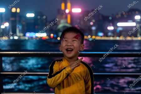 A young boy dressed as Bruce Lee seen on Halloween night at the Victoria Harbor in Hong Kong.