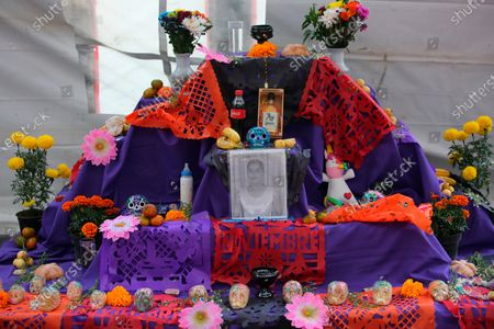 """Stock Image of Portrait of Lilian Garcia Andrade, murdered on Feb. 2002 in Ciudad Juarez, stands on an altar in memory of the victims of femicide at an """"anti-monument"""" that calls attention to femicide, in Mexico City, . Mexico's Day of the Dead celebration this weekend won't be the same in a year so marked by death after more than 90,000 people have died of COVID-19"""