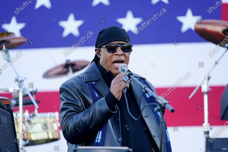 Stevie Wonder speaks before he performs and before Democratic presidential candidate former Vice President Joe Biden and former President Barack Obama speak at a rally at Belle Isle Casino in Detroit, Mich