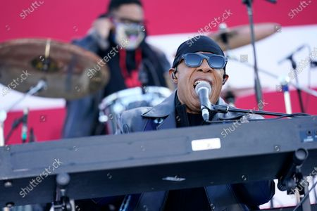 Stevie Wonder performs before Democratic presidential candidate former Vice President Joe Biden and former President Barack Obama speak at a rally at Belle Isle Casino in Detroit, Mich