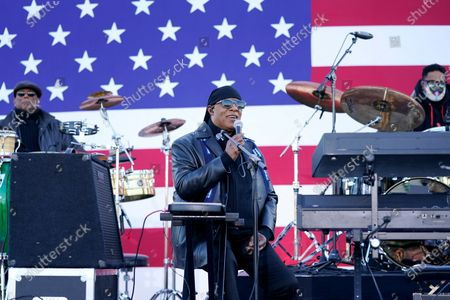 Stock Picture of Stevie Wonder speaks before he performs and before Democratic presidential candidate former Vice President Joe Biden and former President Barack Obama speak at a rally at Belle Isle Casino in Detroit, Mich