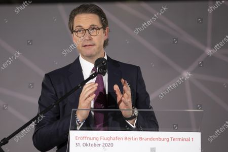 "Stock Image of German Transport Minister Andreas Scheuer speaks to the opening ceremony of the Berlin's airport ""Berlin Brandenburg Airport Willy Brandt"" BER. Berlin Brandenburg Airport. The new airport incorporates former Schoenefeld airport as its Terminal 5 and also replaces Tegel Airport, which will close in coming days. Berlin Brandenburg Airport was originally scheduled to open in 2011 but was stricken by design flaws, corruption scandals, legal wranglings and failed technical audits. The airport will serve Berlin and the surrounding region."