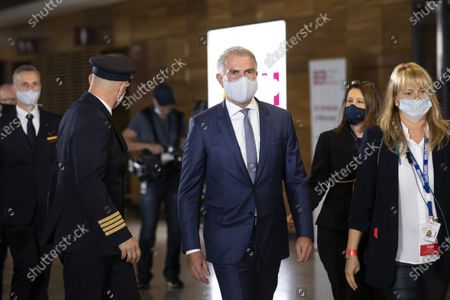 """Stock Photo of CEO of German airline Lufthansa Carsten Spohr arrives to the opening ceremony of the Berlin's airport """"Berlin Brandenburg Airport Willy Brandt"""" BER. Berlin Brandenburg Airport. The new airport incorporates former Schoenefeld airport as its Terminal 5 and also replaces Tegel Airport, which will close in coming days. Berlin Brandenburg Airport was originally scheduled to open in 2011 but was stricken by design flaws, corruption scandals, legal wranglings and failed technical audits. The airport will serve Berlin and the surrounding region."""