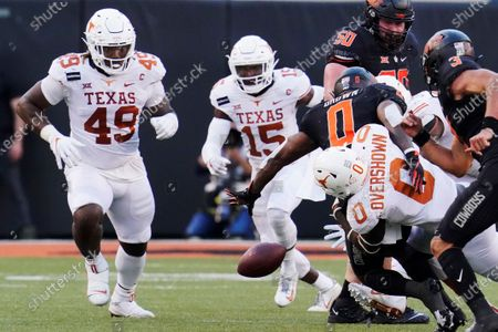 Stock Picture of Oklahoma State running back LD Brown (0) fumbles as he is tackled by Texas linebacker DeMarvion Overshown (0) in the second half of an NCAA college football game in Stillwater, Okla