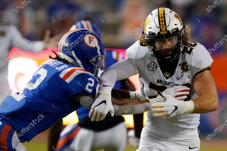 Florida defensive back Brad Stewart Jr. (2) checks Missouri running back Dawson Downing as he runs a pass pattern during the first half of an NCAA college football game, in Gainesville, Fla