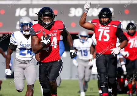 Stock Picture of Cincinnati running back Jerome Ford (24) runs for a touchdown against Memphis as teammate John Williams (75) celebrates during the second half of an NCAA college football game, in Cincinnati. Cincinnati won 49-10