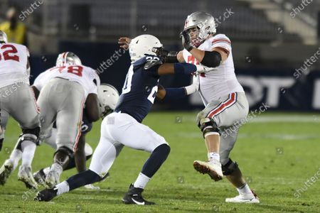 Stock Photo of Ohio State offensive lineman Josh Myers (71) pass blocks Penn State defensive end Adisa Isaac (20) during an NCAA college football game in State College, Pa., on . Ohio State defeated Penn State 38-25