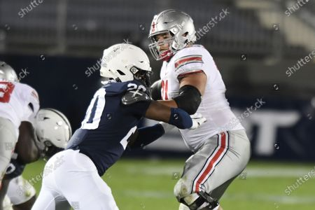 Ohio State offensive lineman Josh Myers (71) pass blocks Penn State defensive end Adisa Isaac (20) during an NCAA college football game in State College, Pa., on . Ohio State defeated Penn State 38-25