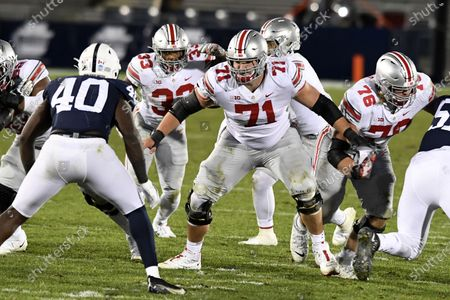 Ohio State offensive lineman Josh Myers (71) looks to block Penn State linebacker Jesse Luketa (40) during an NCAA college football game in State College, Pa., on . Ohio State defeated Penn State 38-25