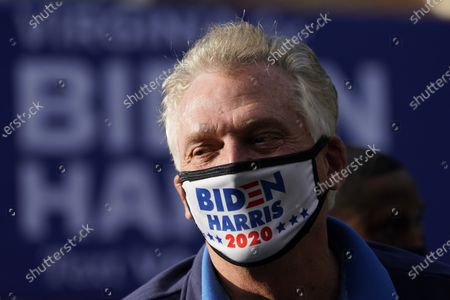Former Virginia Gov.Terry McAuliffe, talks with suporters during a rally in Richmond, Va