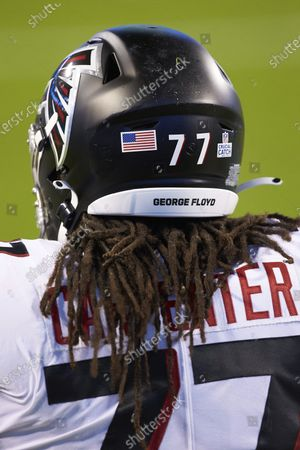 Stock Image of Atlanta Falcons guard James Carpenter (77) prior to an NFL football game against the Carolina Panthers, in Charlotte, N.C