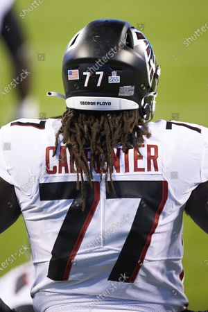 Atlanta Falcons guard James Carpenter (77) prior to an NFL football game against the Carolina Panthers, in Charlotte, N.C