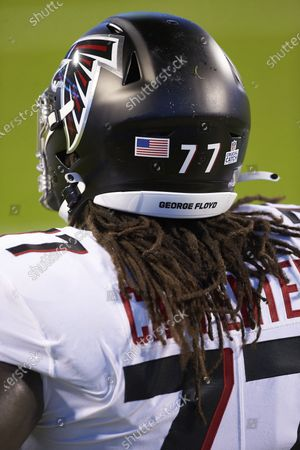 Stock Picture of Atlanta Falcons guard James Carpenter (77) prior to an NFL football game against the Carolina Panthers, in Charlotte, N.C