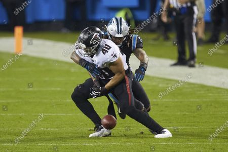 Carolina Panthers linebacker Shaq Thompson (54) breaks up a pass intended for Atlanta Falcons fullback Keith Smith (40) during an NFL football game, in Charlotte, N.C