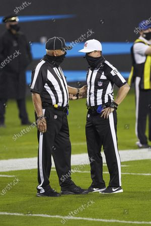 Field Judge Tom Hill (97) chats with Referee Shawn Hochuli (83) during an NFL football game between the Atlanta Falcons and the Carolina Panthers, in Charlotte, N.C
