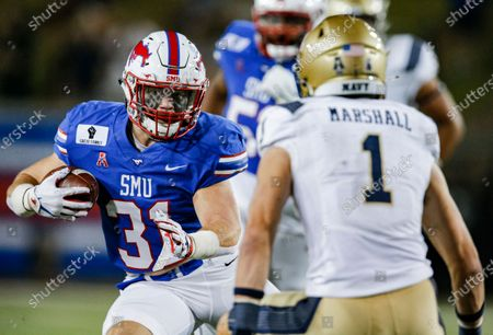 Running back Tyler Lavine (31) looks for room as Navy linebacker John Marshall (1) defends during the first half of an NCAA college football game, in Dallas