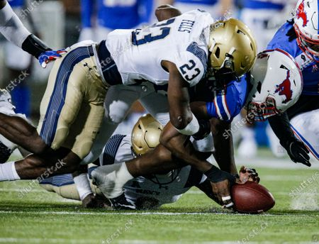 Defensive end Gary Wiley recovers a fumble by Navy quarterback Dalen Morris, bottom, as Navy running back Myles Fells (23) also reaches for the ball during the first half of an NCAA college football game, in Dallas
