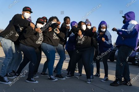 The Detroit Youth Choir dances to Stevie Wonder at a drive-in rally for Vice President Joe Biden on Belle Isle