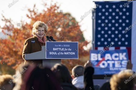 Sen. Debbie Stabenow, D-Mich., speaks at a drive-in rally for Vice President Joe Biden on Belle Isle