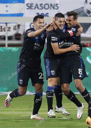 San Jose Earthquakes forward Andres Rios (25), left, forward Cristian Espinoza (10), center, celebrate goal with forward Chris Wondolowski (8),right, who scored against the Real Salt Lake during the first half of an MLS soccer match, in San Jose, Calif