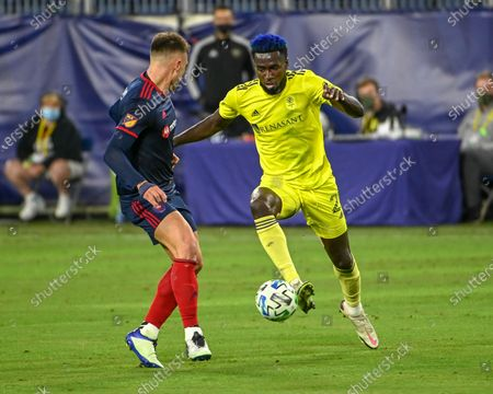 Stock Photo of Nashville midfielder, Derrick Jones (21), and Chicago defender, Francisco Calvo (5), battle for the ball during the MLS match between the Chicago Fire and Nashville SC at Nissan Stadium in Nashville, TN