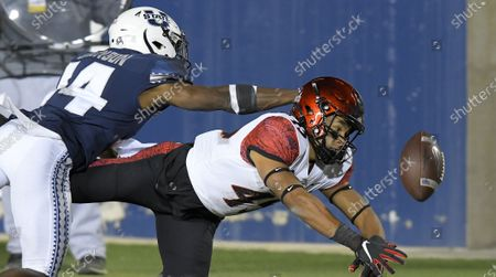 San Diego State wide receiver Jesse Matthews (45) dives the ball as Utah State cornerback Zahodri Jackson (14) defends during the first half of an NCAA college football game, in Logan, Utah
