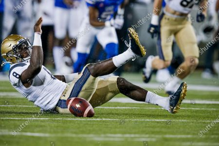 Navy quarterback Dalen Morris, center, fumbles the ball during the first half of an NCAA college football game, in Dallas. SMU defensive end Gary Wiley, not pictured, would recover the ball on the play