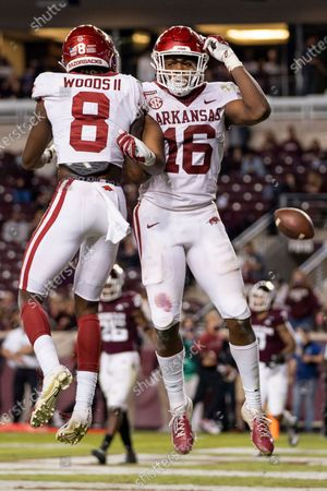 Stock Photo of Arkansas wide receiver Treylon Burks (16) reacts with teammate Mike Woods (8) after scoring a touchdown against Texas A&M during the second half of an NCAA college football game, in College Station, Texas
