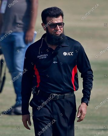 Pakistani umpire Aleem Dar walks back after receiving a souvenir on the record-breaking 210th ODI prior to the start of 2nd one-day international cricket match between Pakistan and Zimbabwe at the Pindi Cricket Stadium, in Rawalpindi, Pakistan, . Dar achieved the record-breaking 210th ODI as the 52-year-old surpassed South Africa's Rudi Koertzen's record of supervising in most one-day internationals