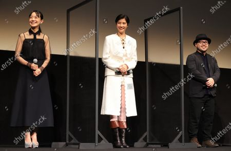 """R) Japanese actresseses Nao, Yui Sakuma and film director Ryohei Yoshino smile as they attend the world premiere of their movie """"Eternally Younger Than Those Idiots"""" for the Tokyo International Film Festival (TIFF) in Tokyo on Sunday, November 1, 2020."""