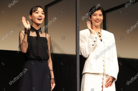 """Japanese actresseses Yui Sakuma (R) and Nao (L) wave their hands to their fans as they attend the world premiere of their movie """"Eternally Younger Than Those Idiots"""" for the Tokyo International Film Festival (TIFF) in Tokyo on Sunday, November 1, 2020."""