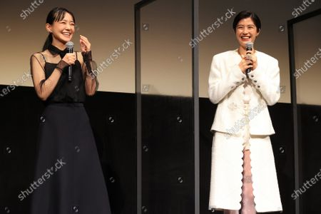 """Japanese actresseses Yui Sakuma (R) and Nao (L) smile as they attend the world premiere of their movie """"Eternally Younger Than Those Idiots"""" for the Tokyo International Film Festival (TIFF) in Tokyo on Sunday, November 1, 2020."""