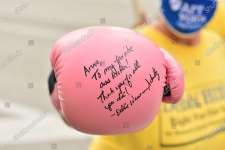 Supporters of Joe Biden and Kamala Harris show a autograph boxing gloves by U.S. Representative Debbie Wasserman Schultz during early voting at the Miramar Branch Library. Both Trump and Biden are focusing their greatest efforts on traditional battlegrounds that will decide the election such as Florida, where both are aggressively campaigning