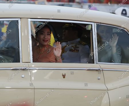 Thai King Maha Vajiralongkorn Bodindradebayavarangkun (2-R), and Thai Queen Suthida (R) with Princess Bajrakitiyabha Mahidol (2-L) and Princess Sirivannavari Nariratana (L) are greeted by supporters as they arrive at the Grand Palace for a Buddhist ceremony for the change of season decoration on the Emerald Buddha statue, in Bangkok, Thailand, 01 November 2020. Royalists gathered to show their support for the Thai King after the pro-democracy protesters held street protests calling for the monarchy reform.