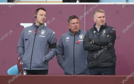 Aston Villa's head coach Dean Smith, right with assistant manages John Terry left and Craig Shakespeare watch the team play from the side lines during the English Premier League soccer match between Aston Villa and Southampton at Villa Park in Birmingham, England
