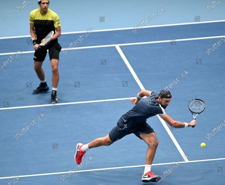 Lukasz Kubot of Poland (R) and Marcelo Melo of Brazil in action during their doubles final match against Jamie Murray and Neal Skupski of Britain at the Erste Bank Open ATP tennis tournament in Vienna, Austria, 01 November 2020.