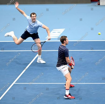 Jamie Murray (up) and Neal Skupski of Britain in action during their doubles final match against Lukasz Kubot of Poland and Marcelo Melo of Brazil at the Erste Bank Open ATP tennis tournament in Vienna, Austria, 01 November 2020.