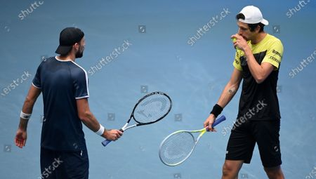 Lukasz Kubot of Poland (L) and Marcelo Melo of Brazil (R) react during their doubles final match against Jamie Murray and Neal Skupski of Britain at the Erste Bank Open ATP tennis tournament in Vienna, Austria, 01 November 2020.